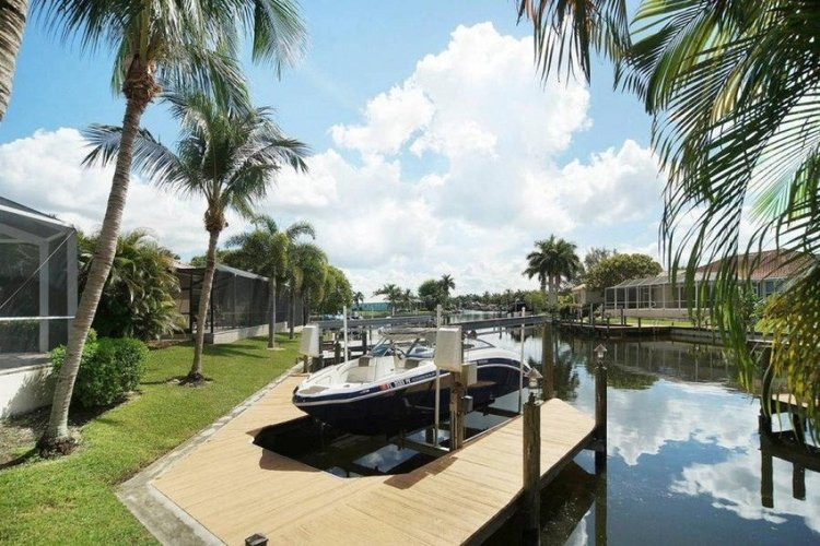 This waterfront villa has a private boat and boat lift