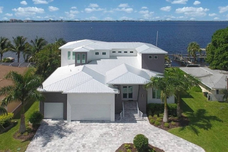 This luxury waterfront villa is located in the Cape Coral Yacht Club