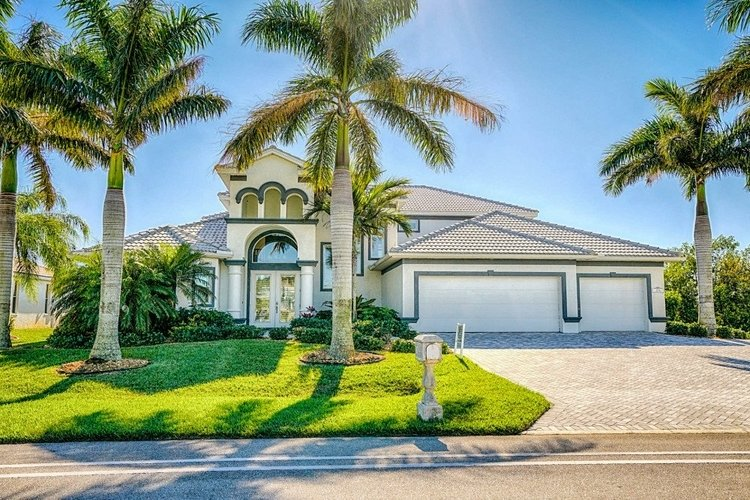 Surrounded by Royal Palms, this 5-bedroom villa is located in Cape Coral