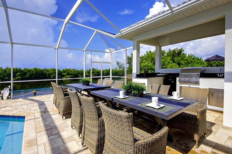 Outside, this villa has a large pool terrace with an alfresco dining area and an outdoor kitchen
