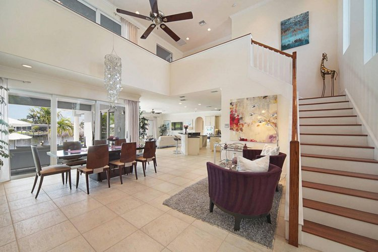 Inside, there is a bright and airy open-plan living and dining area, and a fully equipped kitchen