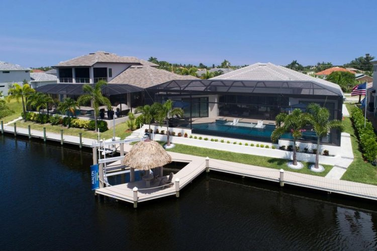 This beautiful 5 bedroom villa is located directly on the waterfront in Cape Coral, just a short distance from the Gulf of Mexico