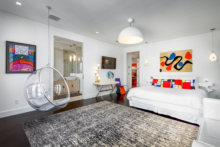 This New York themed bedroom is full of modern art and stylish furnishings