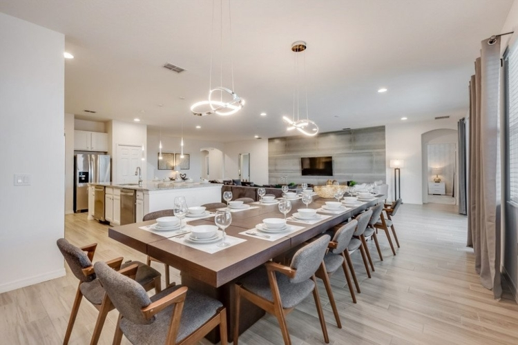 Adjacent to the kitchen, there is a large dining area, with enough space to seat 10 guests