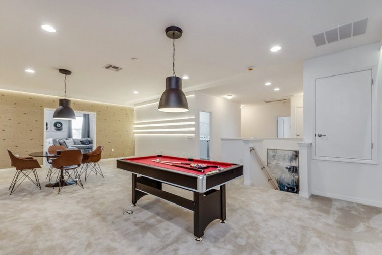The first floor lounge in this villa has a cards table and a billiards table