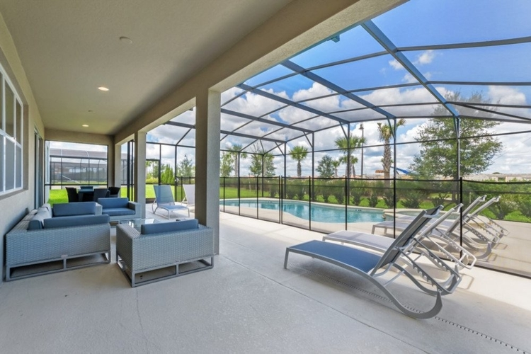 Outside this villa there is a large covered lanai with lounge seating and an alfresco dining area