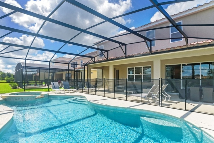 Solterra Resort 254 has a private screened pool with a spillover tub, surrounded by sunloungers