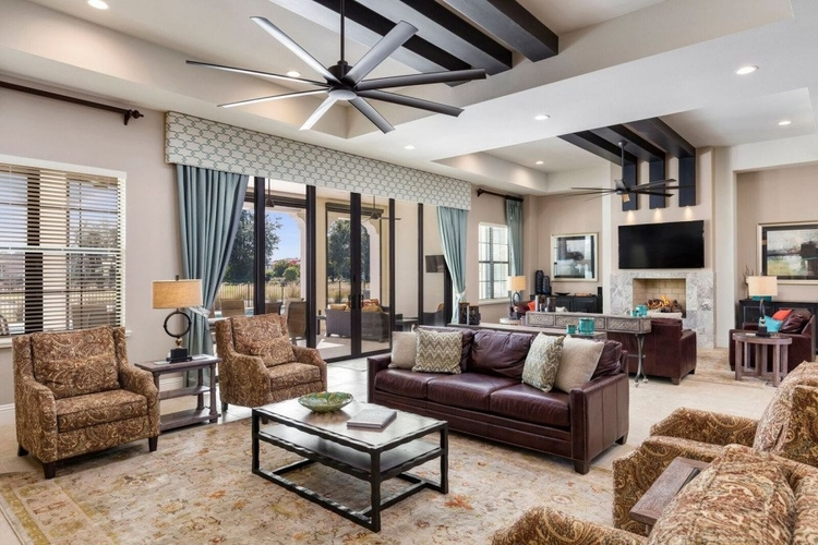 Open-plan living area with lounge seating and access to pool lanai