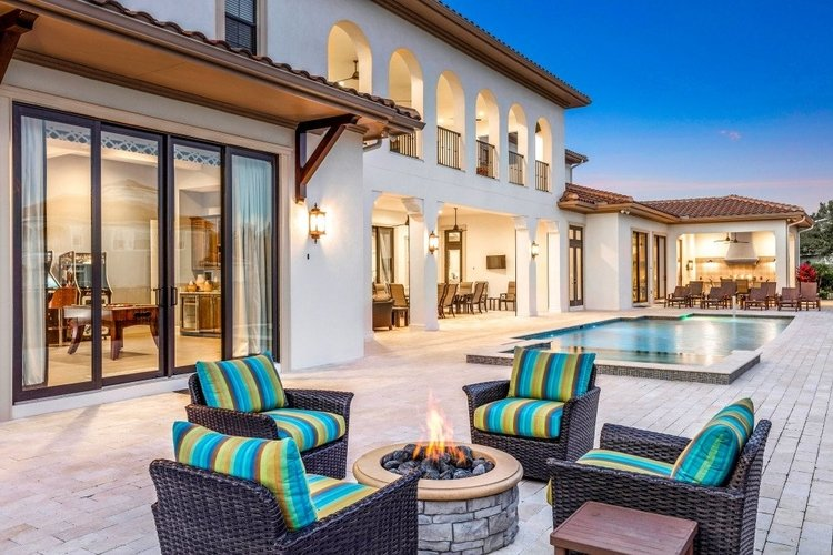 Outside there is a pool terrace with a fire pit, swimming pool and alfresco dining area
