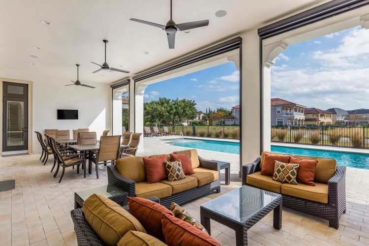 Outside, there is a covered lanai with lounge seating and an alfresco dining area