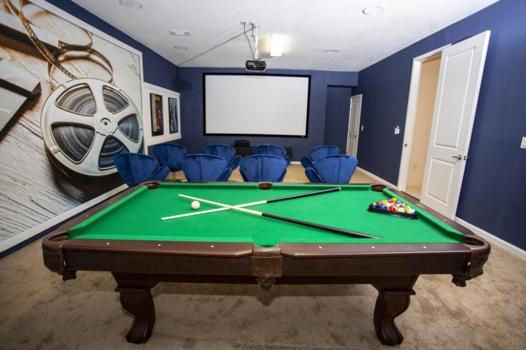 Inside there is a home theater with a pool table