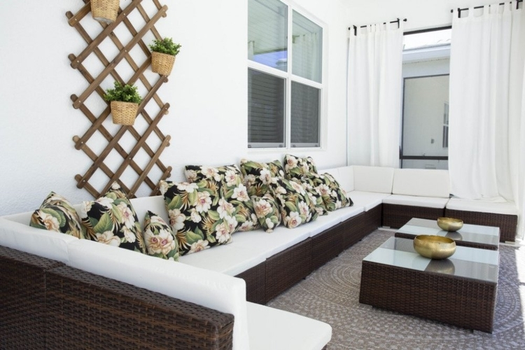 Outside, there is a poolside lounge area with relaxing seating
