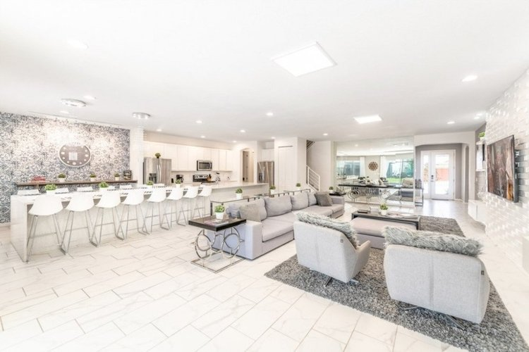 There is an open-plan living and dining area, and a fully equipped kitchen