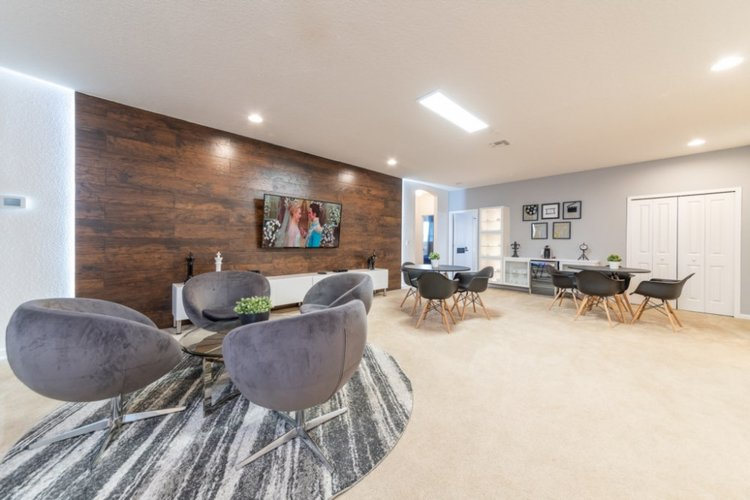 There is a living room upstairs with lounge seating and a flat-screen TV