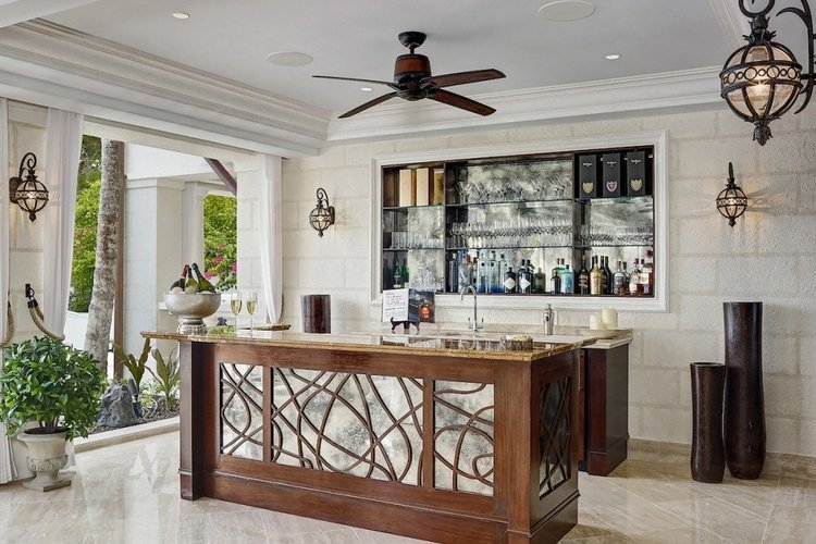 Caribbean villa with a wet bar and butler