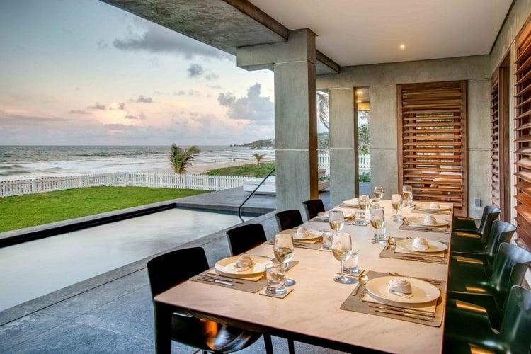 Alfresco dining area overlooking the Caribbean Sea