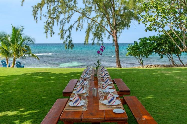 This Caribbean villa has an alfresco dining area overlooking the sea