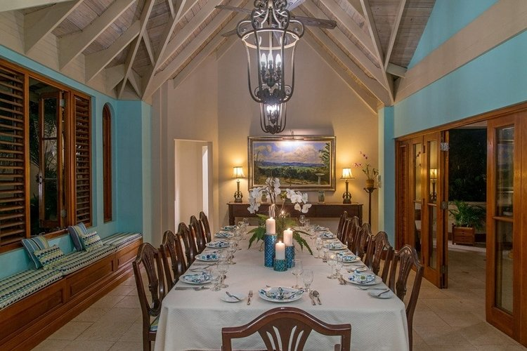 Luxury villa with elegant dining room and butler service