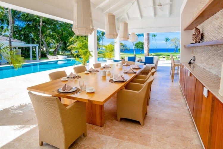 Outside, there is a poolside gazebo with an alfresco dining area and a wet bar