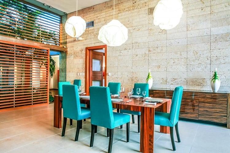 This Caribbean villa has an elegant dining room