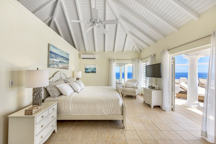 Luxury bedroom with direct access to the pool