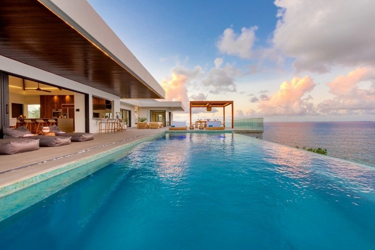 The infinity-edge pool offers sea and sunset views