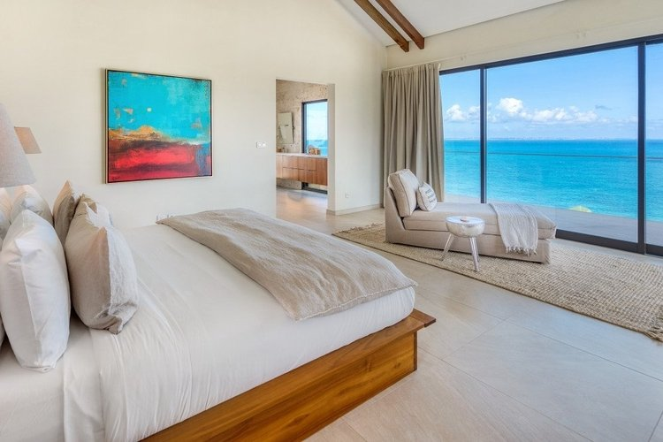 The king-size en-suite bedroom offers a panoramic sea view