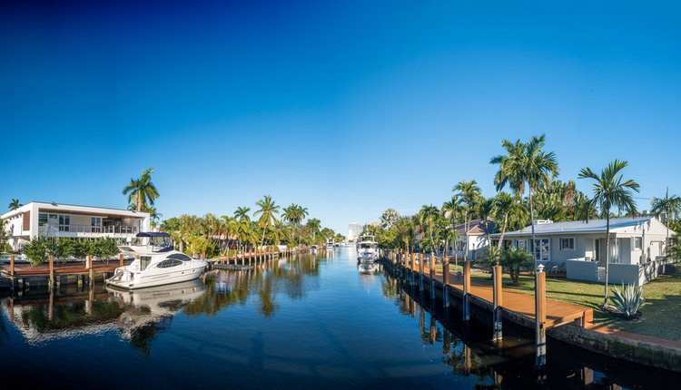 Cape Coral waterway with homes and moored up boats