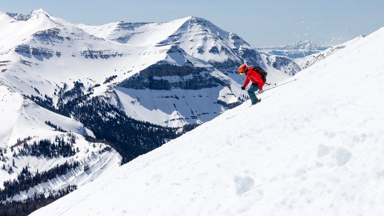 Skier heads down a slope in Big Sky Montana