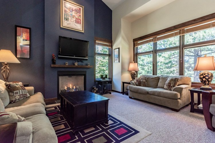The living room in this Mammoth Lakes condo is warm and inviting