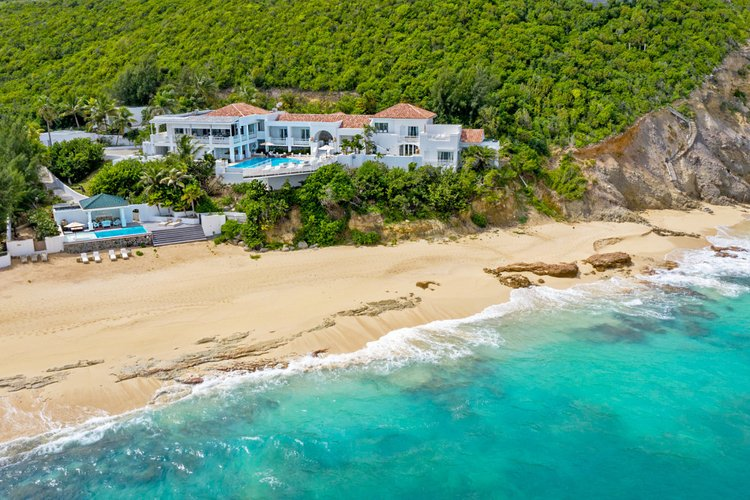 For those looking to be close to the beach, Baie Rouge Hillside 11 offers a beautiful retreat in St. Martin. Private chef and butler included!