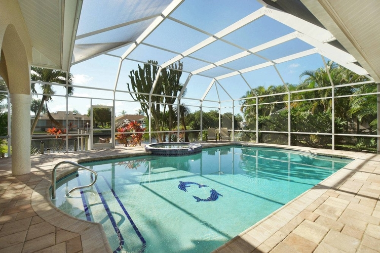 This vacation home in Cape Coral has a private pool