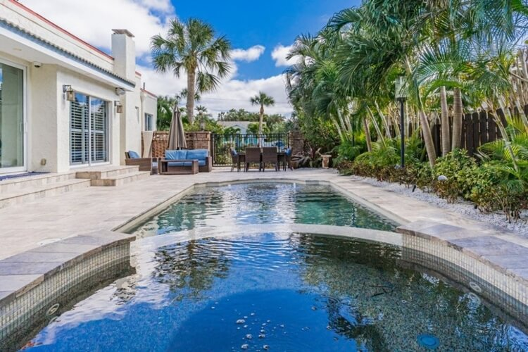 Fans of salt water pools will fall for this stunning bungalow, placed just 50 steps from Clearwater beach!