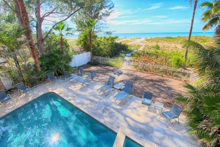 Swim in the private pool or ocean, from this 4-bed vacation home on Treasure Island beach.