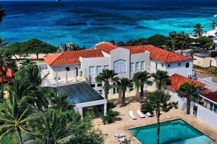 This luxury villa in Aruba is located directly infront of the beach