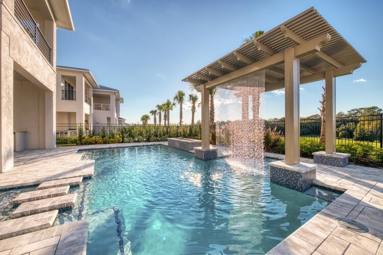 A private pool outside of a Florida villa with a waterfall feature