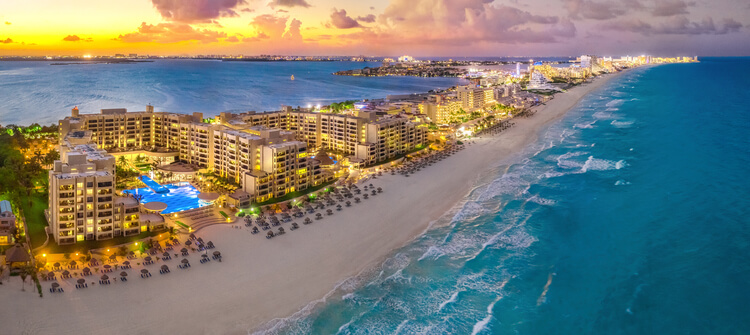 Cancun Beach from above with a strip of high rise luxury hotels