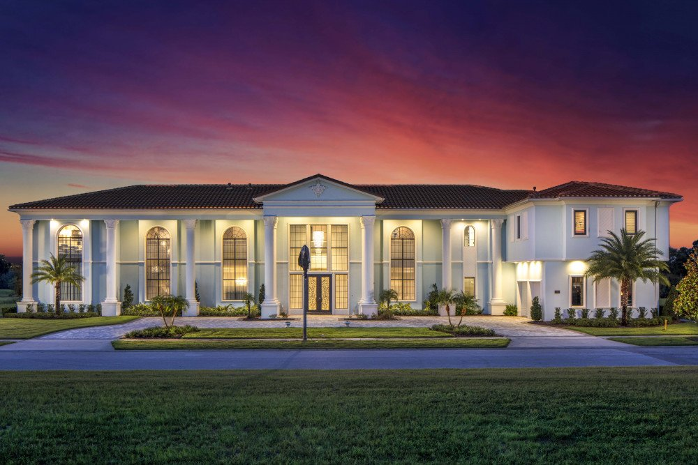 A grand Orlando mansion with columns around the door