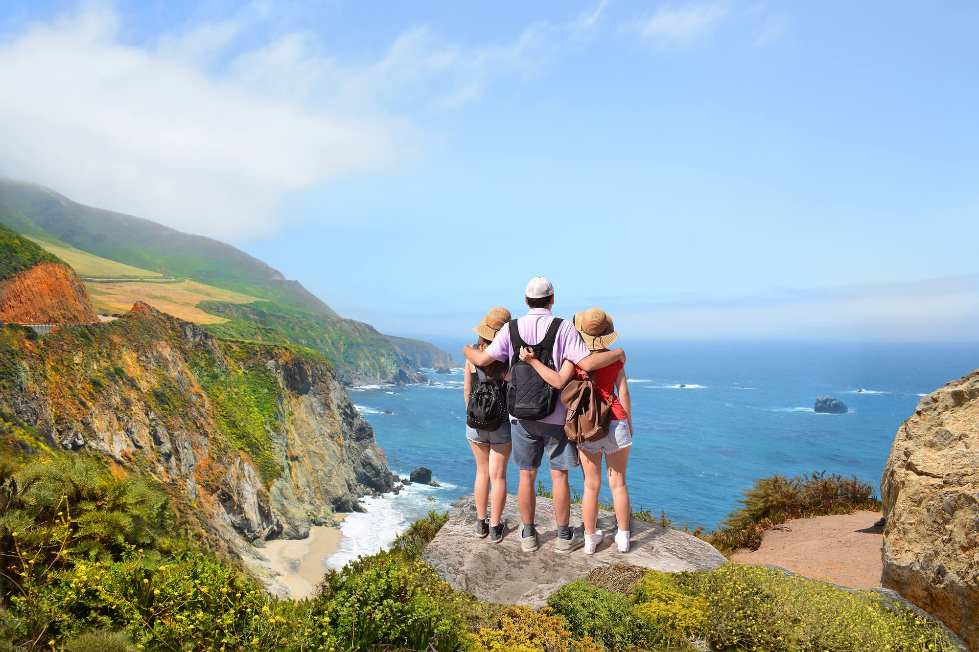 Family looking at the Pacific Coast highway, California