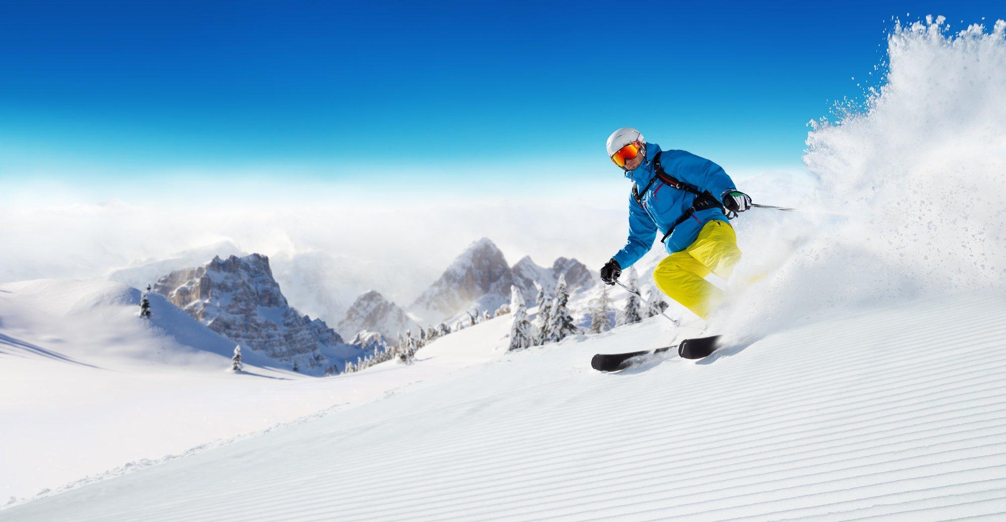 A skier on powder snow